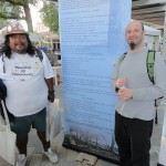 Leo Rhodes and Brian Feist pose with poems they wrote.